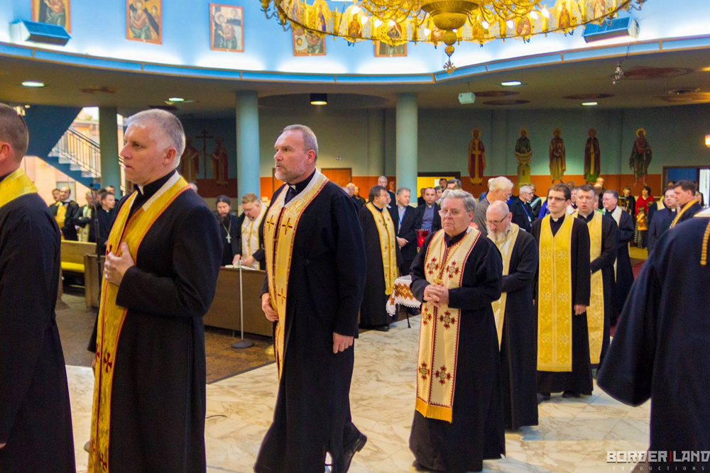 Priests align for communion at St. Joseph church.